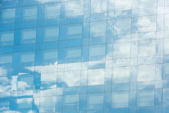 Blue sky and clouds reflected in office building Stock Photography