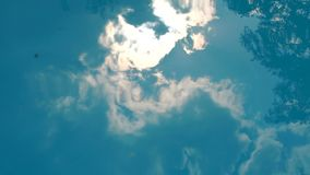 Blue sky and clouds reflected in the water of pool. Blue sky and clouds reflected in the water of the pool, slow motion stock footage