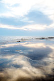 Blue sky and clouds reflected on the water Royalty Free Stock Photo