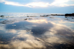 Blue sky and clouds reflected on the water Royalty Free Stock Photos