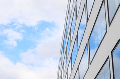 Blue sky and clouds reflected windows of modern building Royalty Free Stock Photos