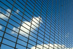 Blue sky with clouds reflections on modern glass business building Royalty Free Stock Images