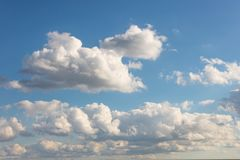 Blue sky with clouds. For sky replacement. Cumulus low hanging stock images