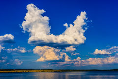 Blue sky with clouds and river. Blue sky background with white clouds and river royalty free stock photography