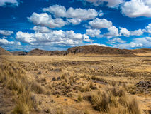 Blue sky with clouds. In the roads of Puno, Peru Stock Images