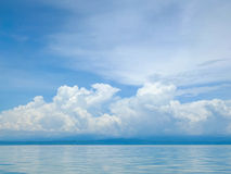 Blue sky. And clouds on the sea Stock Photography
