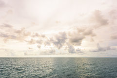 Blue sky with clouds and sea stock image