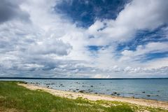 Blue sky with clouds at the sea Royalty Free Stock Photography