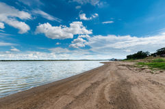 Blue sky with clouds sky with marsh beach Royalty Free Stock Photography