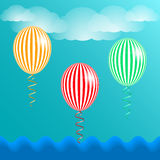 Blue sky, clouds and striped balloons. Vector illustration EPS10 Stock Image