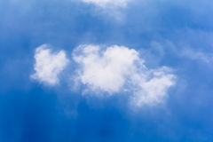 Blue sky and clouds in the summer. (Horizontal royalty free stock photo