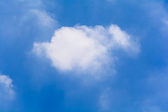Blue sky and clouds in the summer. (Horizontal stock photo