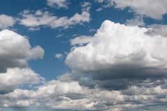Blue sky and clouds in summer season Stock Photo