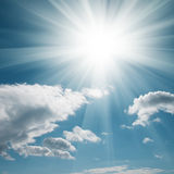 A blue sky with clouds and  sun Stock Images