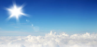 Blue sky with clouds and sun. Background Royalty Free Stock Photo