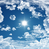 Blue sky. With clouds and the sun Royalty Free Stock Photos