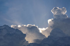 Blue sky with clouds and sun Stock Images