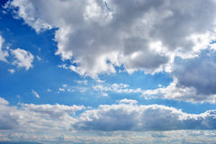 Blue sky. With clouds and sun Stock Image