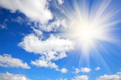 Blue sky, clouds and sun Stock Photo