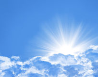 Blue sky with clouds and sun. Background Stock Images
