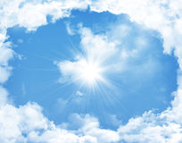 Blue sky with clouds and sun Royalty Free Stock Photos