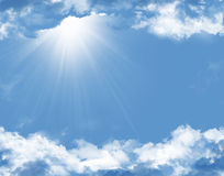 Blue sky with clouds and sun Stock Photo