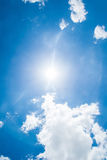 Blue sky with clouds and sun. Royalty Free Stock Photo