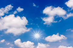Blue sky with clouds and sun. Stock Photos