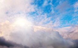Blue sky, clouds and sun behind the clouds Royalty Free Stock Photo