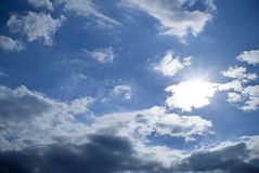 Blue sky clouds sun bright Royalty Free Stock Images