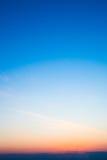 Blue sky, clouds and sun light Stock Image