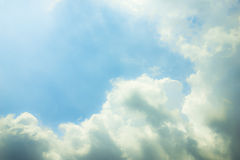 Blue sky, clouds and sun light background Royalty Free Stock Image