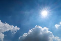 Blue sky and sun light on cloudy day Royalty Free Stock Photos