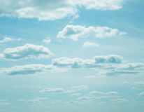Blue sky, clouds and sun light. Royalty Free Stock Images