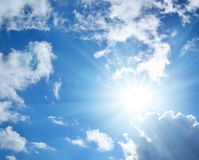 Blue sky. With clouds and sun. Nature composition Stock Images