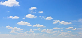 Blue sky with clouds. And sun rays Stock Photography