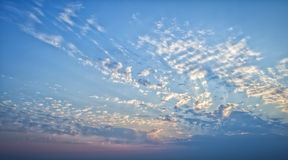 Blue sky with clouds and sun rays. Royalty Free Stock Photo