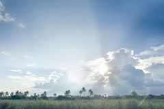 Sun ray, blue sky & clouds. Blue sky & clouds with sun rays, bright & shining, Good for travel or wanderlust background Royalty Free Stock Photography
