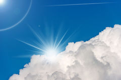 Blue Sky with Clouds and Sun Rays Royalty Free Stock Images