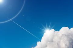 Blue Sky with Clouds and Sun Rays Royalty Free Stock Photos