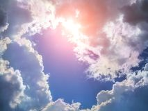 Blue sky with clouds and sun rays. Sunshine Stock Photos