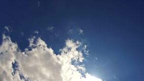 Blue sky with clouds and sun. Summer sky with bright sun and lensflares 4K HD Video stock video