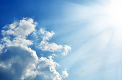 Blue sky with clouds and sun. Stock Photo