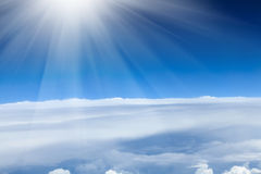Blue sky with clouds and sun Royalty Free Stock Image