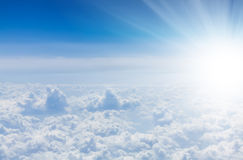 Blue sky with clouds and sun. View from airplane Stock Photos