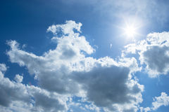 Blue sky with clouds and sun Stock Image