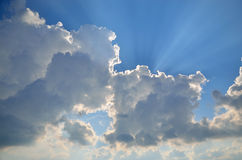 Blue sky, clouds and sunbeams Royalty Free Stock Photography