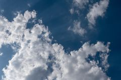 Blue sky with clouds and sunlight stock images