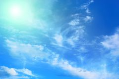 Blue sky with clouds and sunlight Royalty Free Stock Image