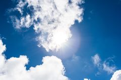 Blue sky with clouds and sunlights stock photo